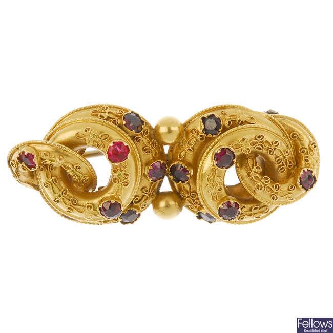 A late 19th century garnet brooch.