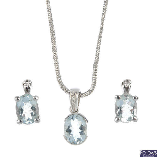An aquamarine and diamond pendant and a pair of ear studs.