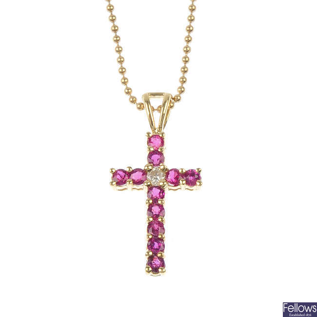 A ruby and diamond cross pendant and chain.