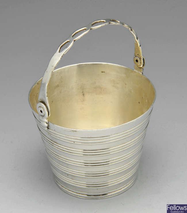 A George II silver cream pail.