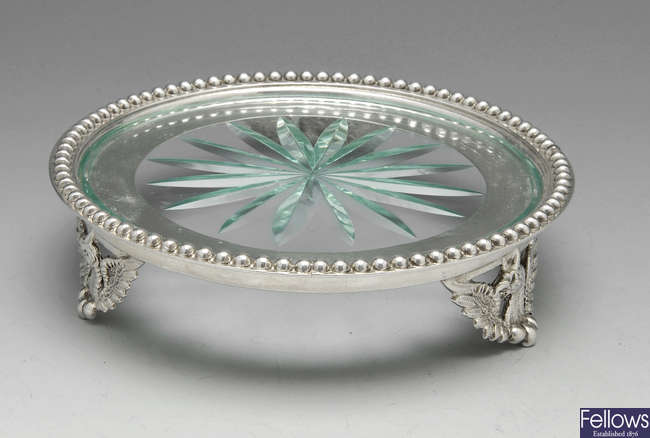 A Victorian silver and glass teapot stand.
