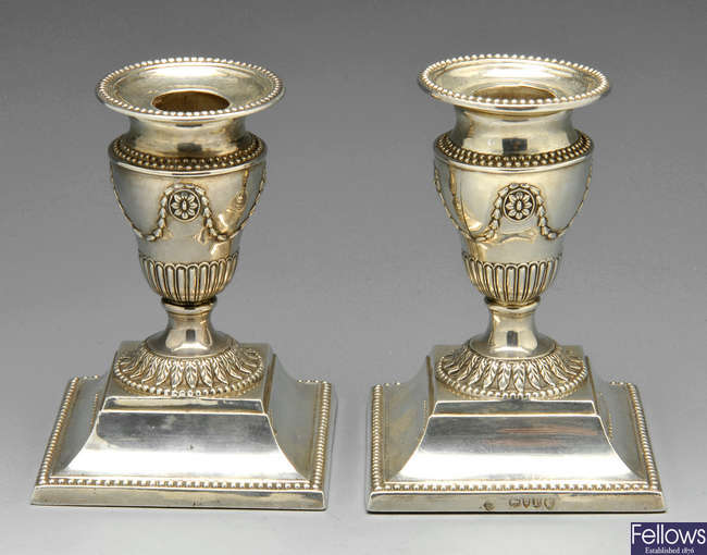 A pair of Victorian silver candlesticks in Neo-Classical style.