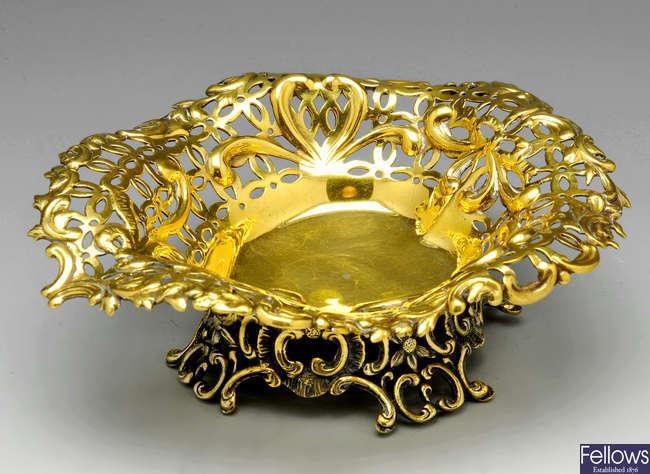A Victorian silver-gilt bonbon dish.