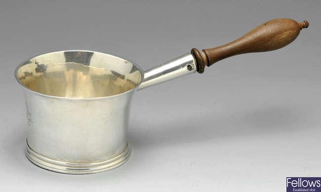 A George I silver brandy pan.