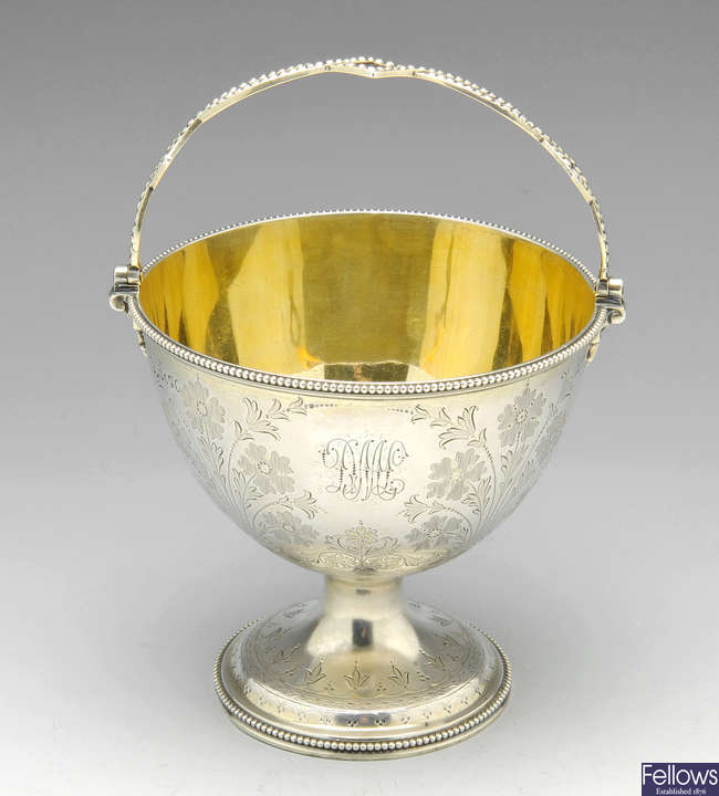 A Victorian silver swing handled sugar basket.