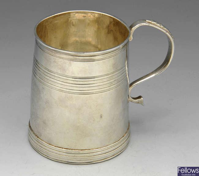 A William III silver half pint mug.