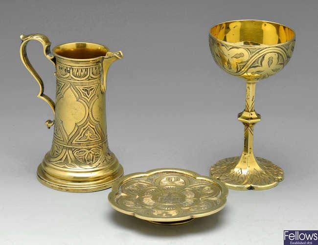 A Victorian silver-gilt travelling communion set.