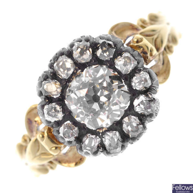 A mid 19th century gold and silver diamond cluster ring.