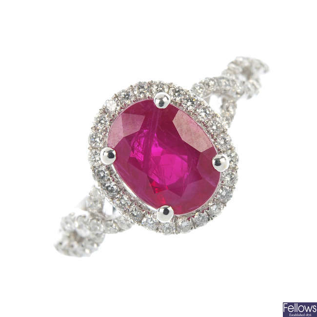 A 14ct gold ruby and diamond cluster ring.