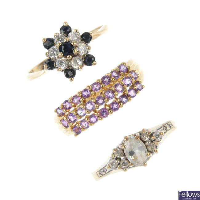 A selection of four 9ct gold gem-set rings.