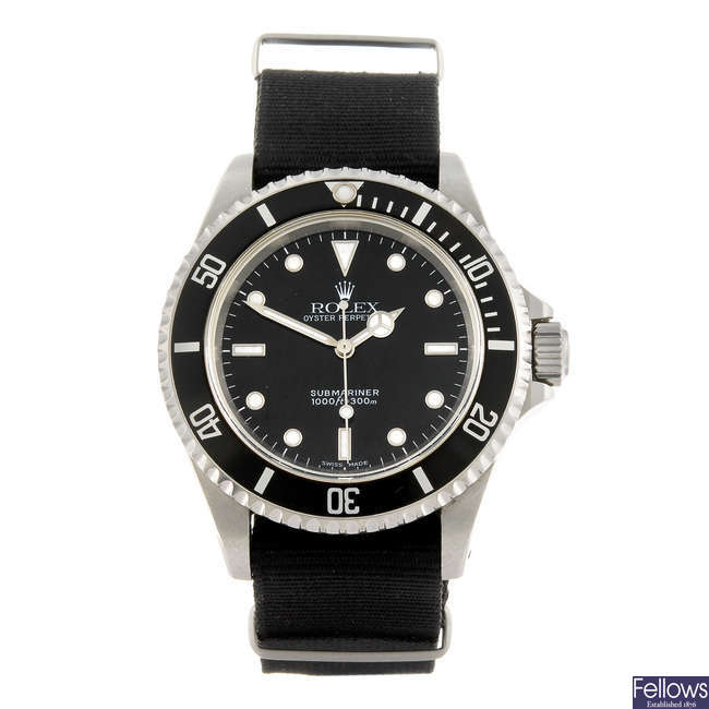 ROLEX - a gentleman's stainless steel Oyster Perpetual Submariner wrist watch.