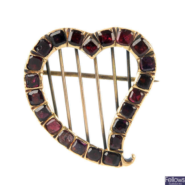 A late 19th century garnet heart brooch.