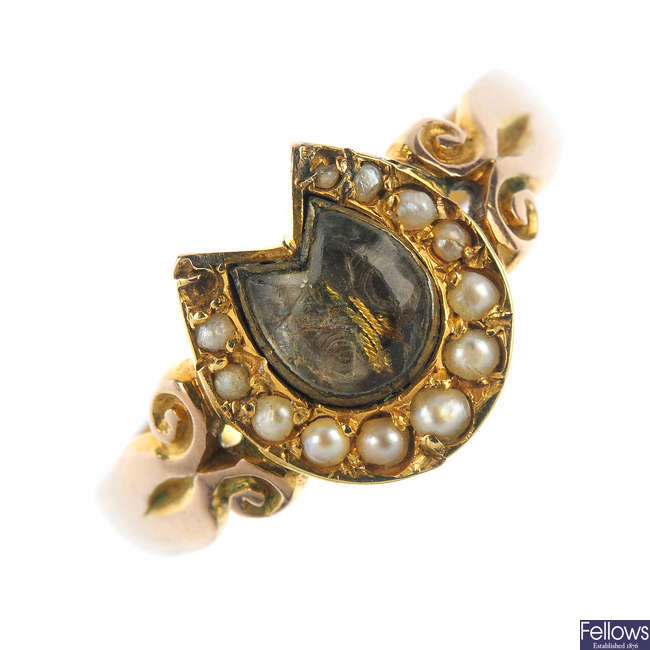 A late 19th century split pearl horseshoe memorial ring.