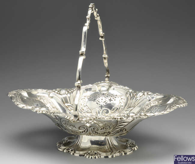 A late Victorian silver swing handled cake basket.
