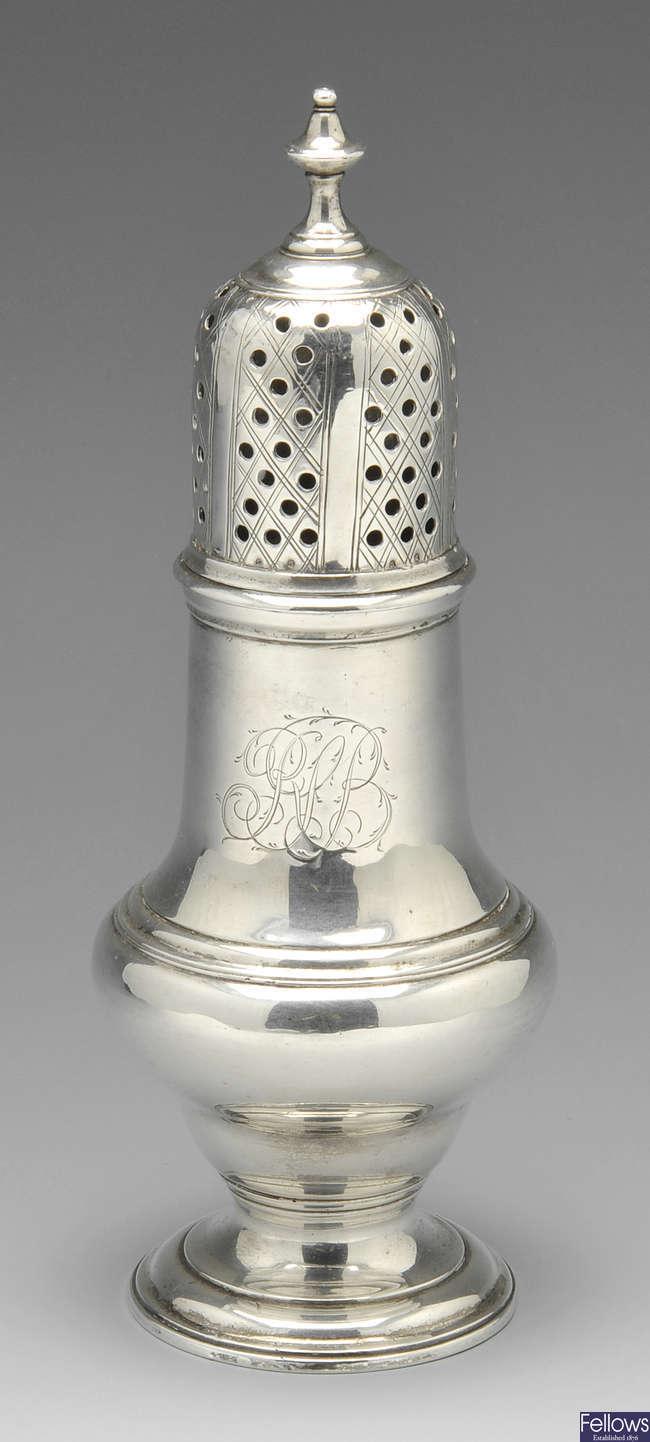 A George II silver caster.