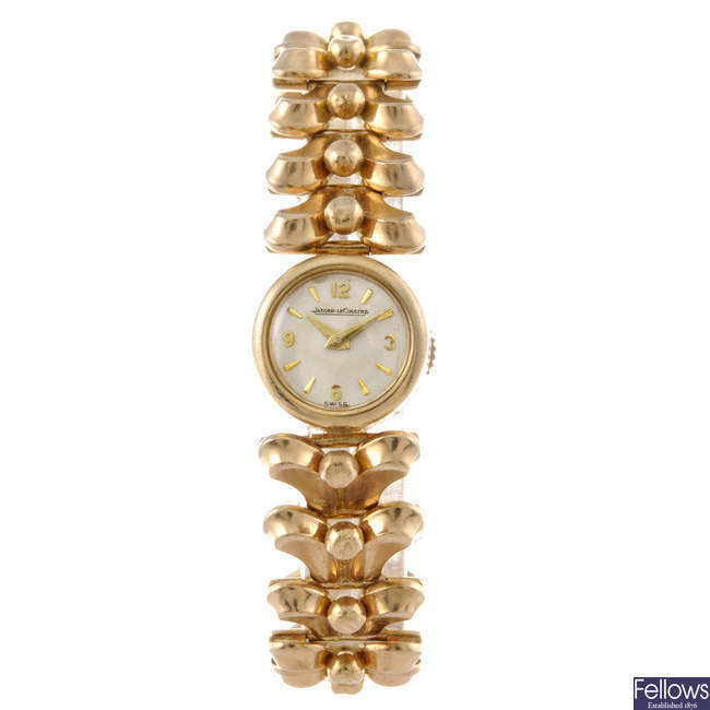 JAEGER-LECOULTRE - a lady's 9ct yellow gold bracelet watch.