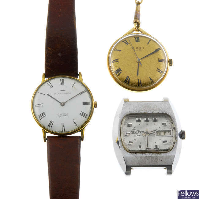 A selection of watches, watch heads and pocket watches.
