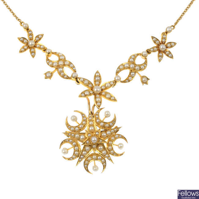 An early 20th century 15ct gold seed and split pearl necklace.