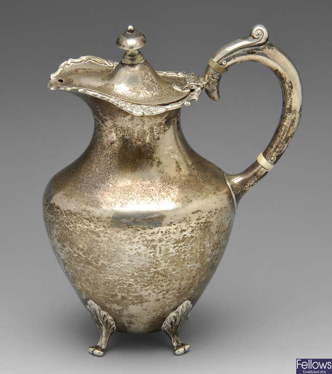 A late Victorian silver hot water jug & 1920's silver sugar bowl. (2).