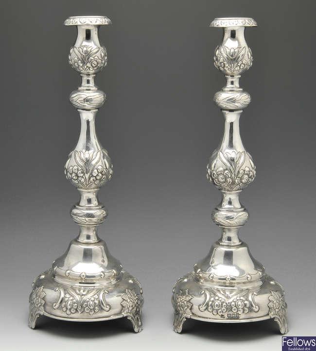 A pair of Edwardian Sabbath candlesticks.