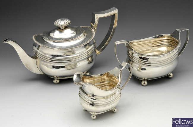 A George III  silver composite three piece silver tea service.