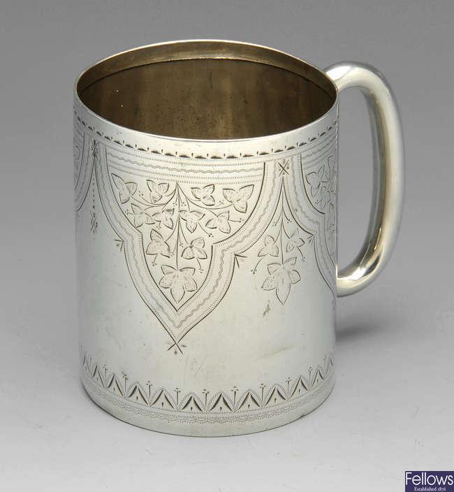 A late Victorian silver christening mug, etc.