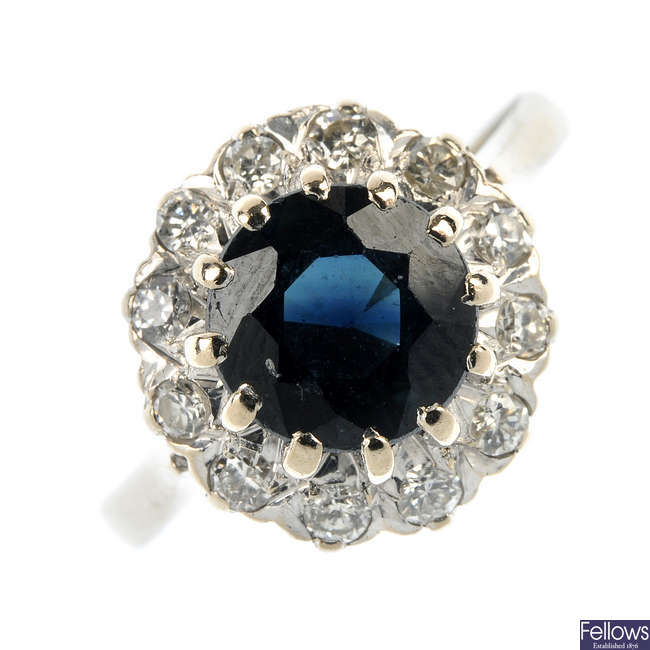 A 1970s 18ct gold sapphire and diamond cluster ring.