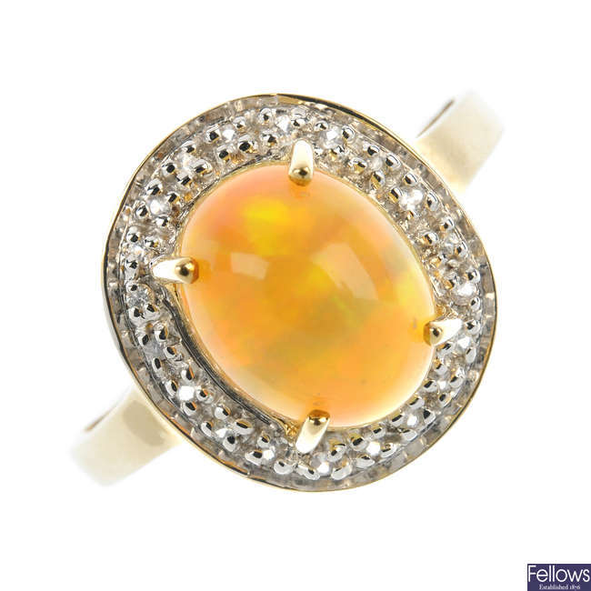 A 9ct gold opal and gem-set cluster ring.