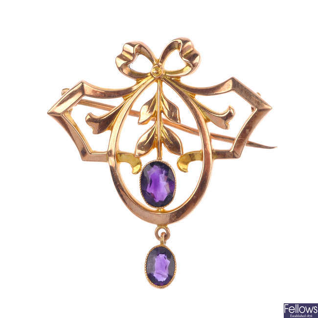 An early 20th century 9ct gold amethyst brooch and two pairs of gem-set earrings.