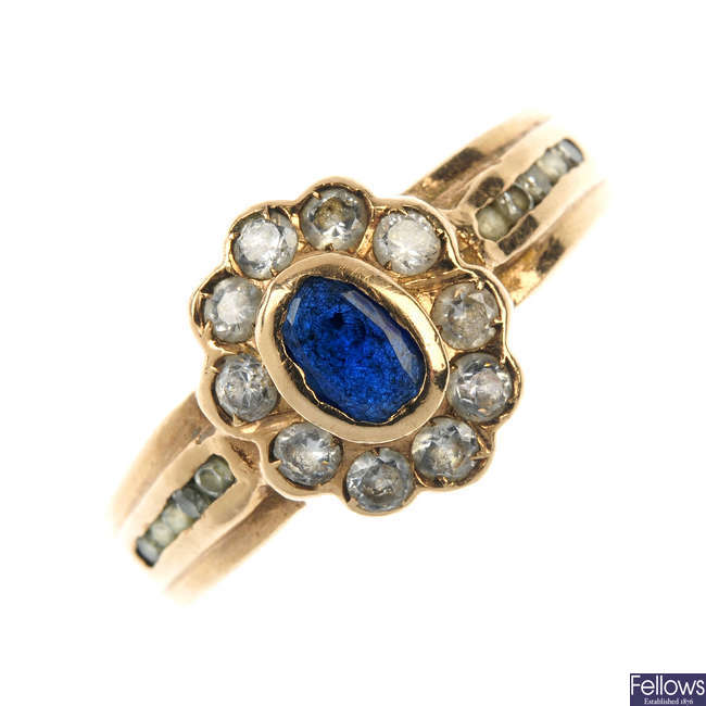 A 9ct gold sapphire and cubic zirconia cluster ring.