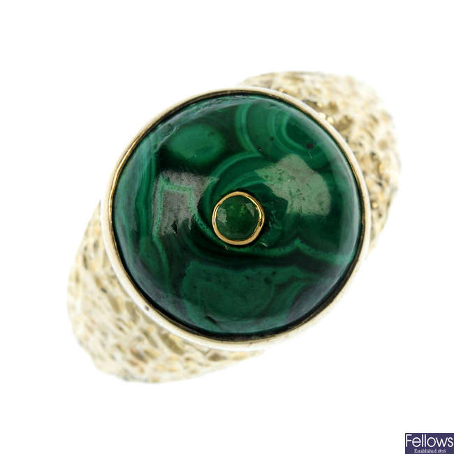 A malachite and emerald dress ring.