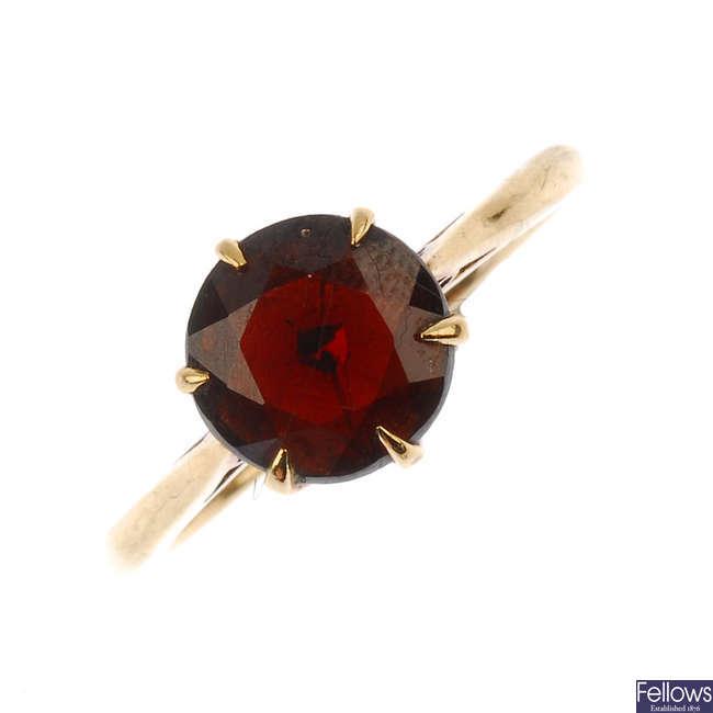 A mid 20th century 9ct gold garnet single-stone ring.