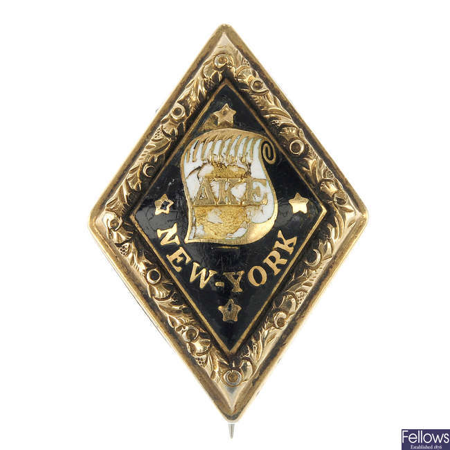 A mid 19th century enamel Yale college fraternity pin.
