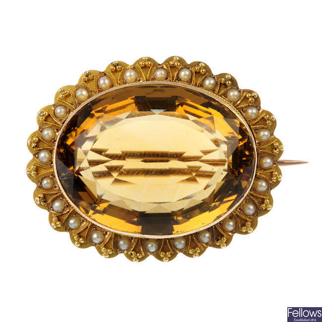 A citrine and split pearl brooch.