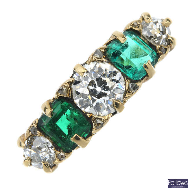 An early 20th century 18ct gold emerald and diamond five-stone ring.