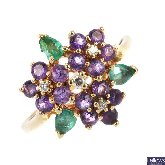 A diamond, emerald and amethyst floral dress ring.