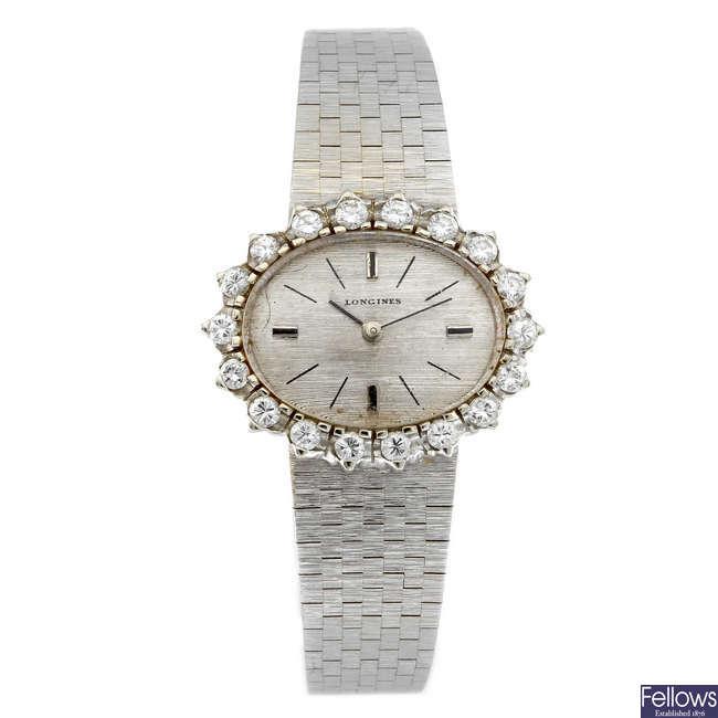 LONGINES - a lady's white metal bracelet watch.