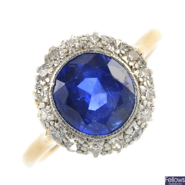 A mid 20th century 18ct gold and platinum sapphire and diamond cluster ring.