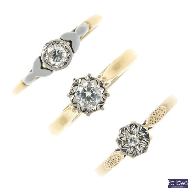 A selection of three gold diamond single-stone rings.