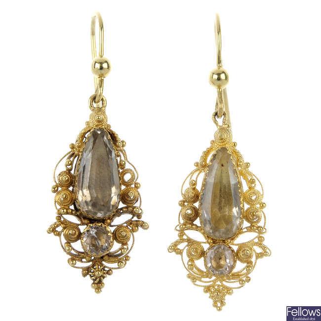 A pair of foil-back quartz ear pendants.