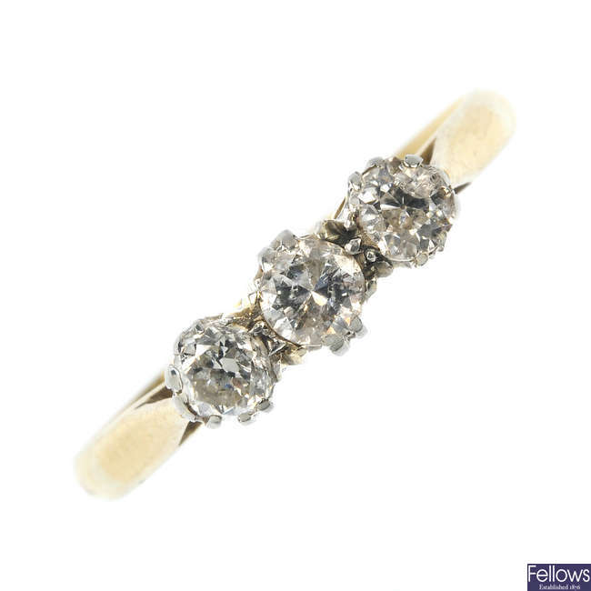 A mid 20th century 18ct gold and platinum diamond three-stone ring.