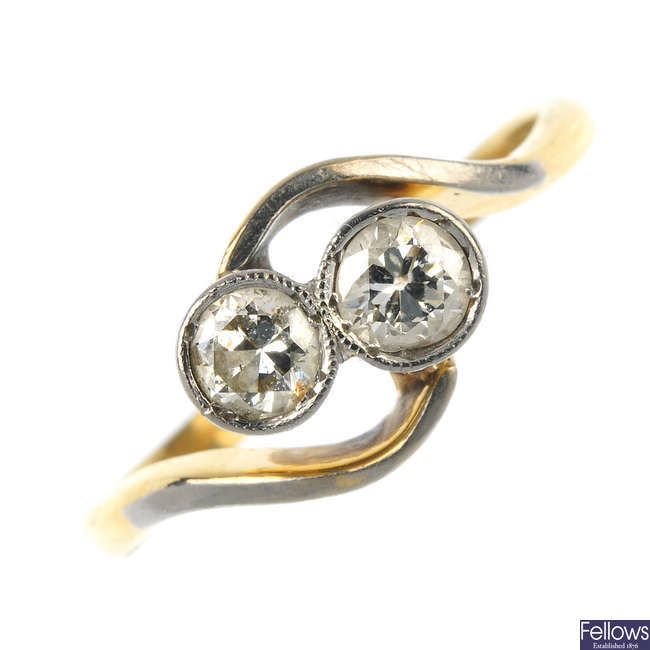 A mid 20th century 18ct gold and platinum diamond two-stone ring.