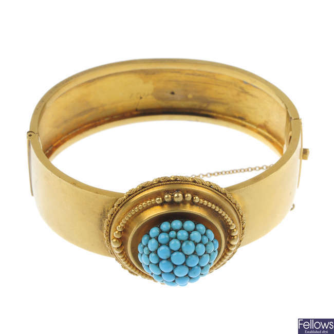 A late 19th century gold turquoise bangle.
