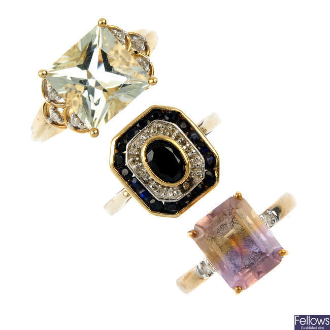 A selection of three 9ct gold diamond and gem-set rings.