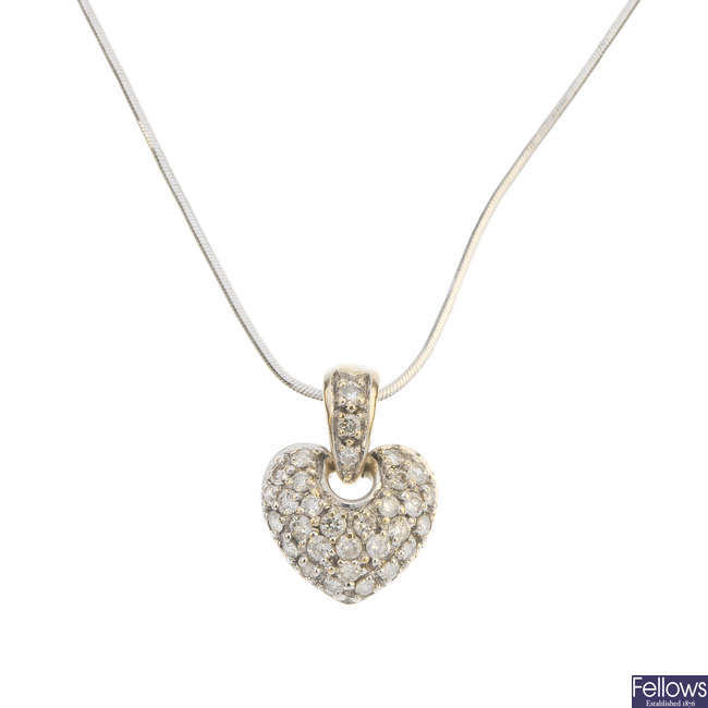 A diamond heart pendant.