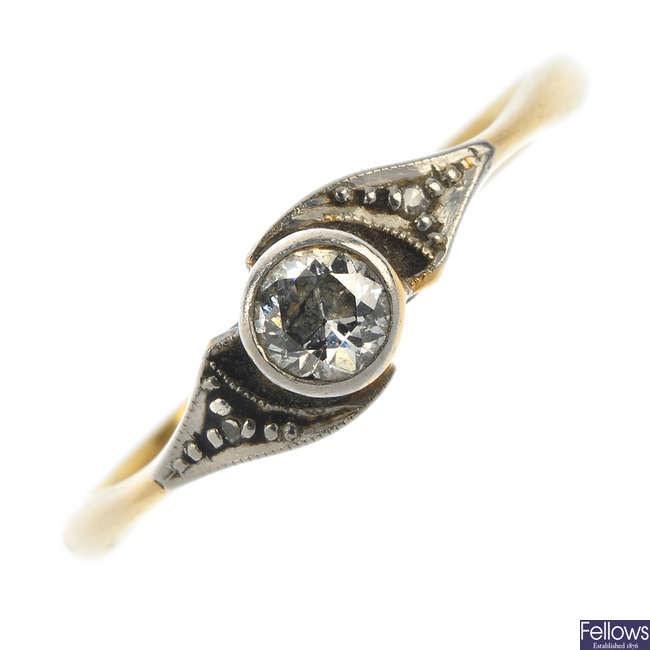 A mid 20th century platinum and 18ct gold diamond single-stone ring.
