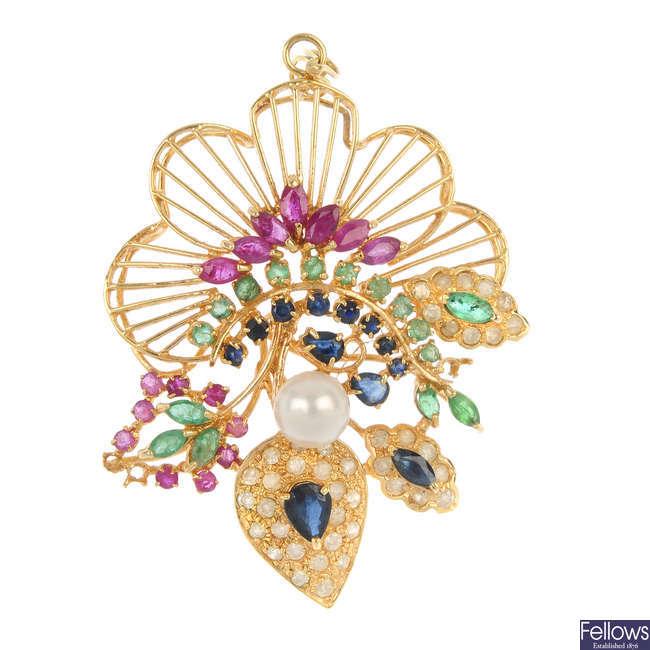A diamond cultured pearl and gem-set pendant.