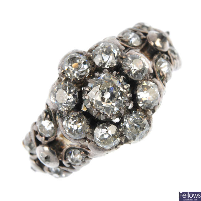 A mid 19th century silver and gold diamond cluster ring.