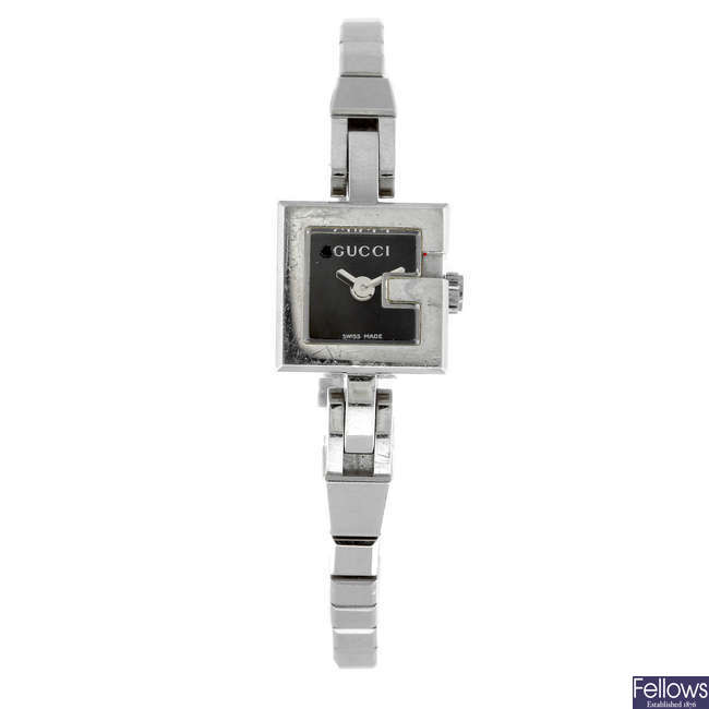 GUCCI - a lady's stainless steel G Mini bracelet watch.