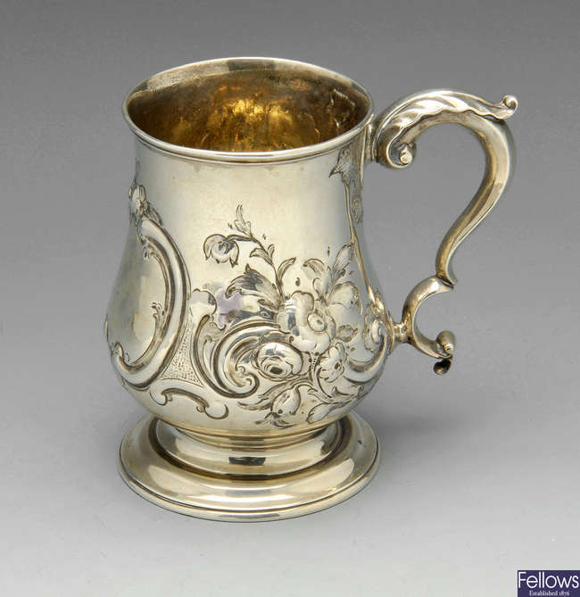A Victorian silver embossed mug.